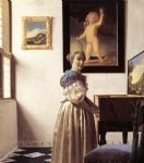 lady standing at a virginal by johannes vermeer painting