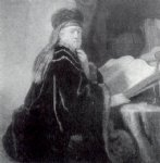 rembrandt van rijn a scholar seated at a desk painting